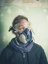 Young woman with dust mask and goggles Royalty Free Stock Photo