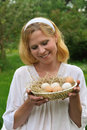 Young woman and Easter eggs Royalty Free Stock Photos