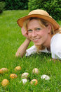 Young woman and easter eggs on the grass - Easter Royalty Free Stock Image