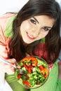 Young woman eat salad. Healthy vegetarian food.