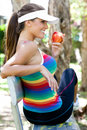 Young Woman Eating Apple on Park Bench Royalty Free Stock Images