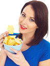 Young Woman Eating Baked Potato Crisps Royalty Free Stock Photo
