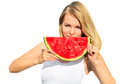 Young woman eating big slice watermelon berry fresh in hands beautiful smiling face and blonde hair organic food concept isolated Stock Image