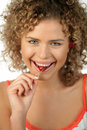 Young woman eating cherry Royalty Free Stock Image