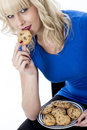 Young Woman Eating a Chocolate Chip Cookie Biscuit Royalty Free Stock Photo