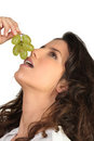 Young woman eating grapes Royalty Free Stock Photos