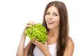 Young woman eating green salad isolated on white background Stock Photography