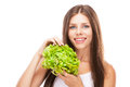 Young woman eating green salad isolated on white background Stock Photos