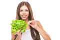 Young woman eating green salad isolated on white background Royalty Free Stock Photo