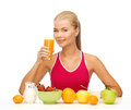 Young woman eating healthy breakfast with and drinking orange juice Stock Photography