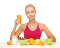 Young woman eating healthy breakfast with and holding orange juice Stock Photography