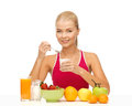 Young woman eating healthy breakfast picture of Royalty Free Stock Photo