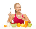 Young woman eating healthy breakfast picture of Royalty Free Stock Images