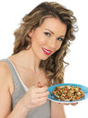 Young Woman Eating Holding a Plate of Healthy Mixed Bean Salad Royalty Free Stock Photo