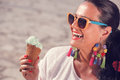 Young woman eating ice cream on the street Royalty Free Stock Photo
