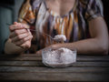 Young woman eating ice cream at table Royalty Free Stock Photo