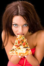 Young woman eating a piece of pizza Royalty Free Stock Photo