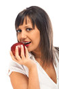 Young woman eating red apple isolated on white background with copy space Royalty Free Stock Images