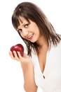 Young woman eating red apple isolated on white background with copy space Royalty Free Stock Photos