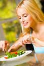 Young woman eating salad Royalty Free Stock Photography