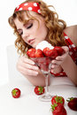 Young Woman eating strawberries Royalty Free Stock Photo