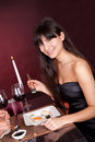 Young woman eating sushi in restaurant Stock Photo