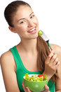 Young woman eating vegetable salad Stock Photo