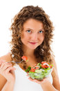 Young woman eating vegetable salad isolated white background Stock Photography
