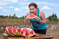 Young woman eating watermelon. Royalty Free Stock Image