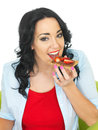 Young Woman Eating Wholewheat Cracker with Chocolate Spread and Fresh Sliced Strawberries Royalty Free Stock Photo