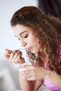 Young woman eating yogurt Royalty Free Stock Photo