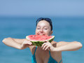 Young woman eats watermelon Royalty Free Stock Photo