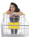 Young woman with empty shopping cart Royalty Free Stock Images