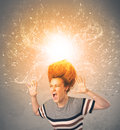Young woman with energetic exploding red hair concept on background Royalty Free Stock Photo