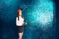 Young woman engineer looking at project sketch Royalty Free Stock Photo