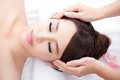 Young woman enjoy massage at spa beautiful face with roses asian beauty Stock Image