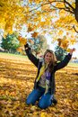 Young woman enjoying in autumn park Stock Images