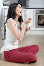 Young woman enjoying breakfast Royalty Free Stock Images