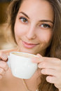 Young woman enjoying coffee. Royalty Free Stock Images