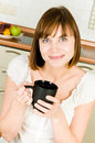 Young woman, enjoying a cup of coffee in her home. Stock Photo