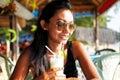 Young Woman Enjoying A Drink I...