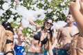 Young woman  enjoying  a foam party on the beach Royalty Free Stock Photo