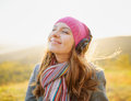 Young woman enjoying a music in the fall season a autumn outdoor portrait Royalty Free Stock Images