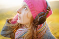 Young woman enjoying a music in the fall season autumn outdoor portrait Royalty Free Stock Images
