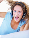 Young woman enjoying music on headphones Stock Photos