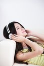 Young woman enjoying the music at home beautiful asian beauty Stock Images