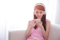 Young woman enjoying the music at home beautiful asian beauty Royalty Free Stock Image