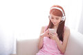 Young woman enjoying the music at home beautiful asian beauty Royalty Free Stock Photos