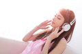 Young woman enjoying the music at home beautiful asian beauty Royalty Free Stock Images