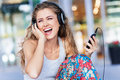 Young woman enjoying music urban wearing headphones Royalty Free Stock Photo